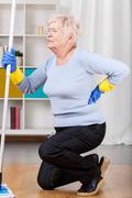 Elderly woman having back pain Stock Photos