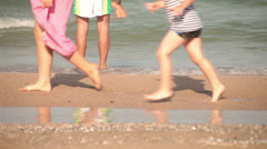 Young adult swimmer man wetting and conditioning feet in ocean. Stock Footage
