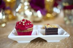 Fancy gourmet cupcake and slice of cake at a wedding Stock Photos