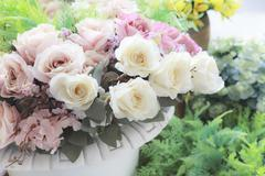 vintage pastel color style of white roeses flowers bouquet arranged for decor - stock photo