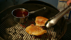 Flipping Chicken on the Grill Stock Footage