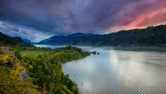 Columbia River Gorge in Hood River Oregon at Sunset with Colorful Stormy Clouds - stock footage