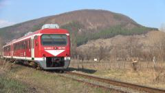 Passengers Train Rides in Countryside in Mountains, View of Locomotive Passing Stock Footage