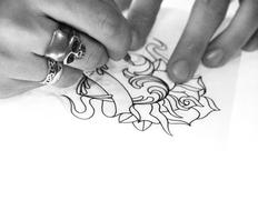 Tatto artist drawing sketch Stock Photos