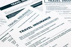 travel insurance form and paperwork for insurance business - stock photo