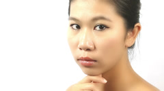Thoughtful asian woman Stock Footage