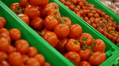 Tomatoes lie on a counter Stock Footage