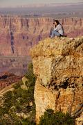 woman photographer taking last pictures at the south rim - stock photo