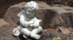 Cherub Statue on ground Stock Footage