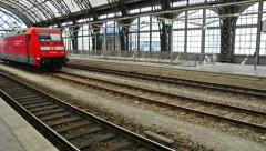 railroad station of  Germany with announcement - stock footage