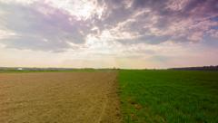 Spring landscape with plowed and green field, timelapse Stock Footage