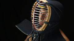 Kendo fighter over black background Stock Footage