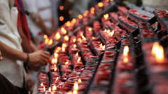 People lit candle in Catholic Church Basilica del Santo Nino . Cebu, Philippines Stock Footage