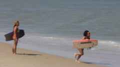 Attractive Girl Rides Boogie Board Stock Footage