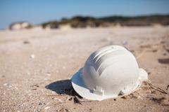 Pollution - plastic hard hat on beach Stock Photos