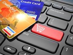 Verkkokaupoissa. luottokortilla kannettavan tietokoneen näppäimistön. verkkokaupan. Piirros