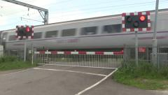 Barrier going up at a level crossing. Stock Footage