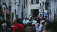 Stock Video Footage of Tourists Walking through Narrow Market Street in Amalfi - 25FPS PAL