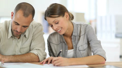 young people filling application form - stock footage