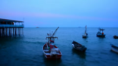 Small fishing boats at dusk. Stock Footage