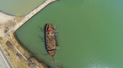 Aerial view of a rusty old ship - stock footage