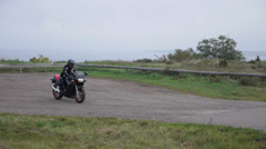 Girl on the motorcycle, forest road Stock Footage