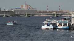 Pleasure ships moored to floating station on Neva river, St. Petersburg, Russia Stock Footage