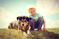 Young child outside with his dog, vintage style Stock Photos
