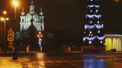 Smolny cathedral and Christmas tree at dark sky background Stock Footage