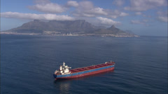 Aerial approach of Cape Town with red tanker Stock Footage