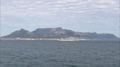 Very low aerial approach of Cape Town passing white tanker Stock Footage