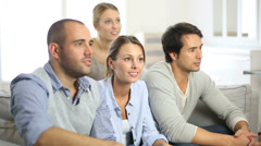 Group of friends watching football game on tv Stock Footage