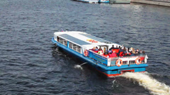 Tourists in cruise on pleasure passenger boat along Neva river, St. Petersburg Stock Footage