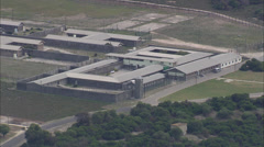 Close up aerial view of Robben Island prison Stock Footage