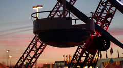 Sunset Ride | Dutch Wheel with brilliant sunset - stock footage