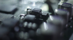 Circuit board macro shot with dramatic lighting Stock Footage