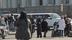 Policeman giving traffic ticket for motorcyclist standing with bike, Russia Stock Footage