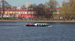 Stock Video Footage of Pleasure ship with passengers voyaging near Peter and Paul fortress on Neva riv