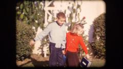 Vintage film home movie kids going to school leaving home Stock Footage