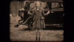 Vintage film home movie girls jumping ropes 1940s Stock Footage