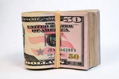 folded wad fifty dollar bills american money cash tender - stock photo