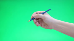 Caucasian hand writing with blue pen on green chromakey background Stock Footage