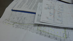 Construction Drawings. Construction plans at engineer desk Stock Footage
