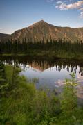 alaska territory mountain lake marsh vertical banner blue sky - stock photo