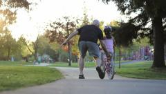Girl Practices Riding Her New Bike With Dad - stock footage