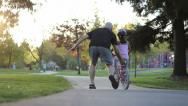 Stock Video Footage of Girl Practices Riding Her New Bike With Dad