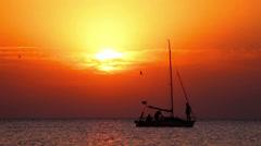 Boat at sunset. Yacht sailing at sea sunset. Sailboat at lake at sunset Stock Footage