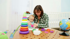 Mother and Child Painting In Playroom Stock Footage