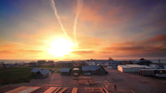 Sunset at sea village time lapse. Sun sets over horizon. Sunset background Stock Footage