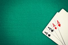four aces on green casino table - stock photo